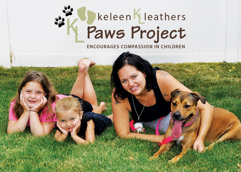 Keleen Mullen with her children and their pup Fiona